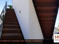 Scala-esterna-in-acciaio-con-rampa-e-ballatoio03